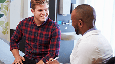 Young Man Speaking With Doctor Image