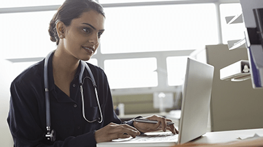 female physician at computer