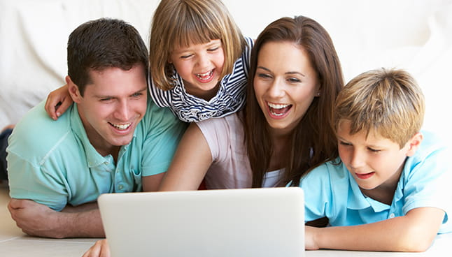 Family looking at a laptop