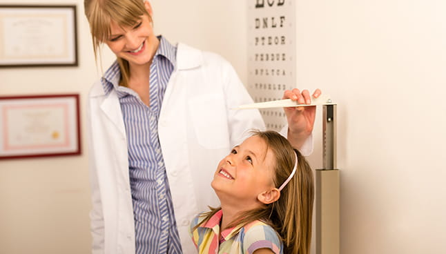 Child's height being measured by a doctor
