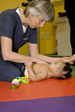 A doctor assists a patient with brachial plexus injuries.