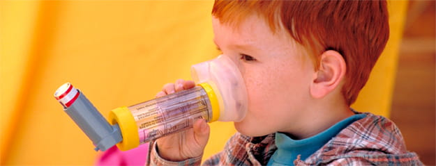 Boy using an asthma inhaler