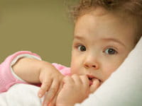 Young girl with finger in her mouth
