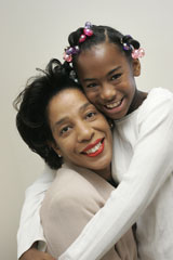 Bridgett pictured with her mom after her implant.