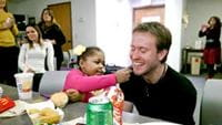Jamie Folmar feeds french fries to David Denovchek, her liver transplant donor.