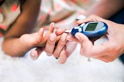 person checking insulin levels