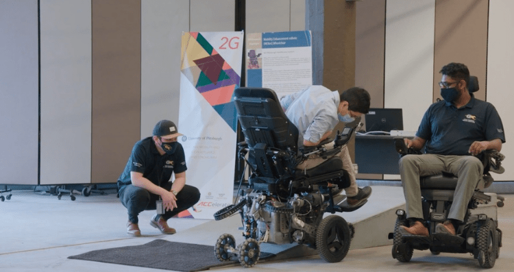 two men in wheelchairs