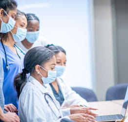 Image of physicians doing research on computer.