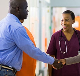 Nurse greeting patient | UPMC Patients and Visitors