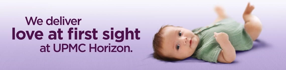 """A purple background featuring a picture of a playing baby wearing a green jumper. There is purple text which reads: """"We deliver love at first sight at UPMC Horizon."""""""