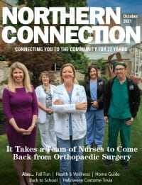 The UPMC Passavant orthopaedic surgery team stands together posing for the cover of Northern Connection Magazine.