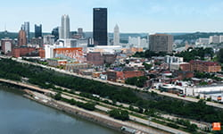 Pittsburgh skyline with UPMC Vision and Rehabilitation Hospital.