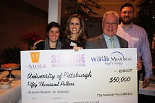 The Woiner Foundation representatives L to R: Sarah Pearman, Jessica Fera and Ric Fera and John T. Kirkwood, M.D.  (2nd from right)