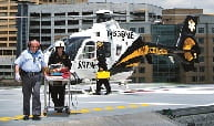 A patient is transferred from a STAT MedEvac to UPMC Presbyterian Hospital. Credit: UPMC.