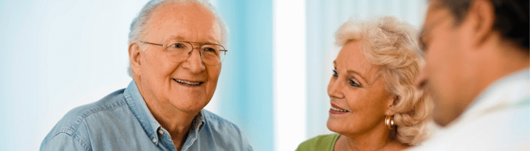 An older couple speaks with a diabetes doctor.