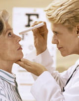 Eye doctor with a patient